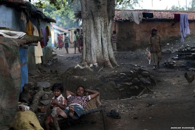 Noradores de favelas locais não têm para onde ir (Foto: Arindam Mukherjee)