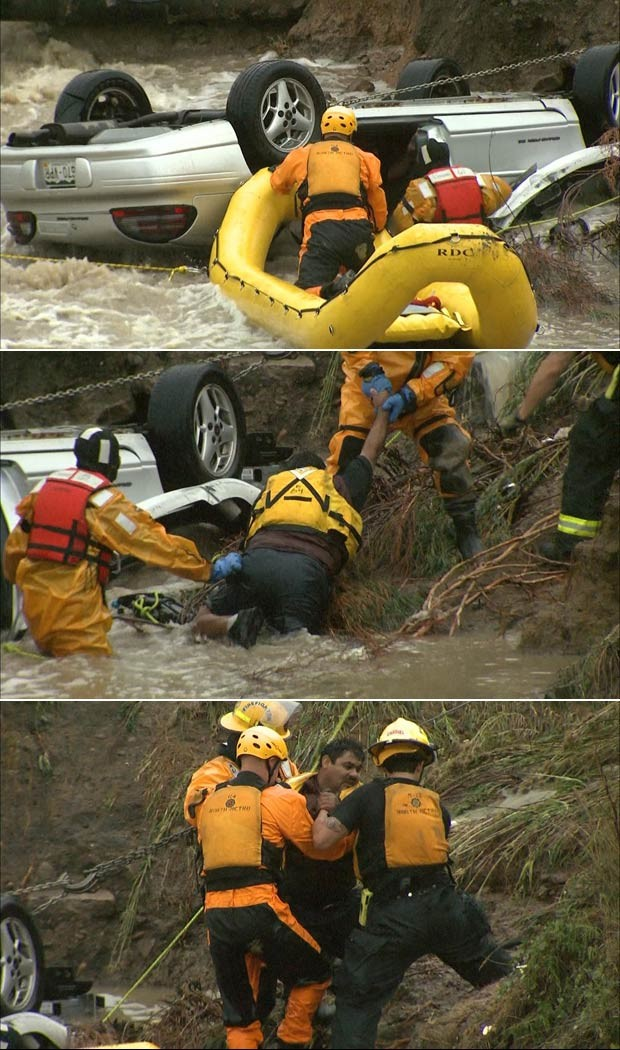 Sequência mostra resgate de homem preso sob carro durante enchente em Lafayette, no Colorado (Foto: Reuters/CBS4 Denver)