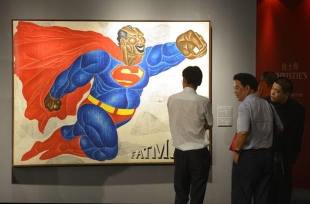 Quadro de 'super-homem fora de forma' superou R$ 1,6 milhão em leilão (Foto: Peter Parks/AFP)