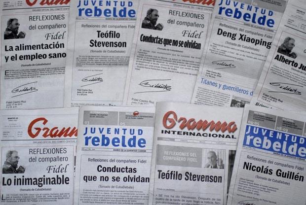 Capas dos jornais cubanos 'Granma' e 'Juventud Rebelde' (Foto: AFP)