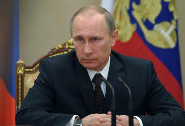 O presidente da Rússia, Vladimir Putin, em foto desta sexta-feira (21) no Kremilin, em Moscou (Foto: RIA-Novosti, Alexei Druzhinin, Presidential Press Service/AP)