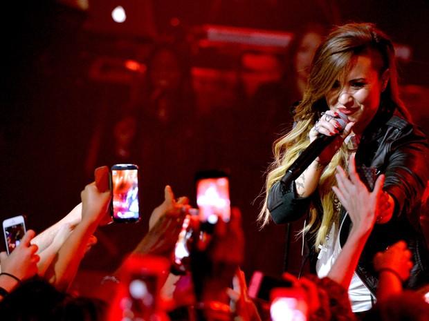 Demi Lovato se apresenta em Burbank, no estado americano da Califórnia, em abril de 2014 (Foto: Kevin Winter/Getty Images/AFP)
